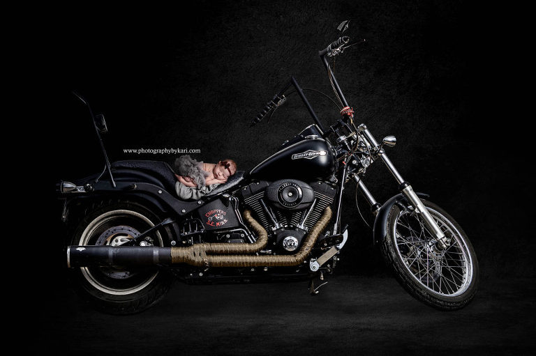newborn composite photo with motorcycle photographed by Photography by Kari