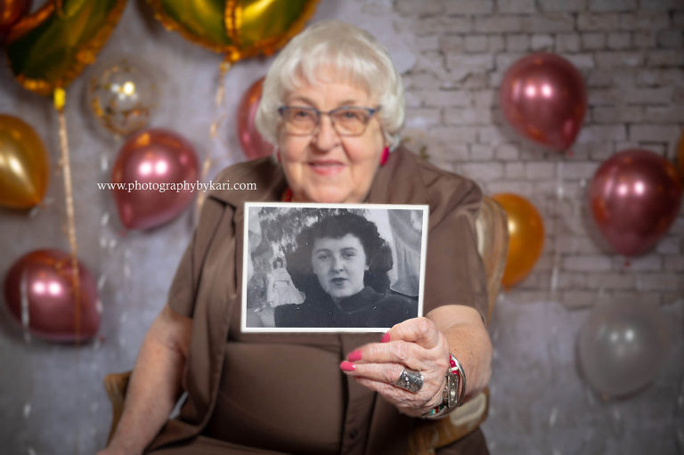 ellen mcgill holding old photo of herself photographed by Kari McGill