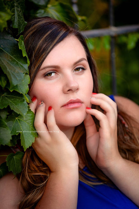 high school girl leaning in flower vines