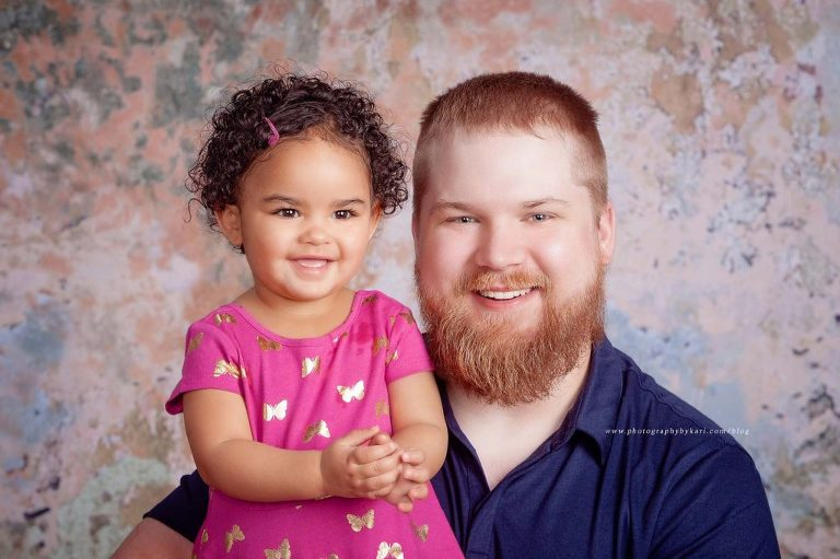 Daughter and father smiling portrait