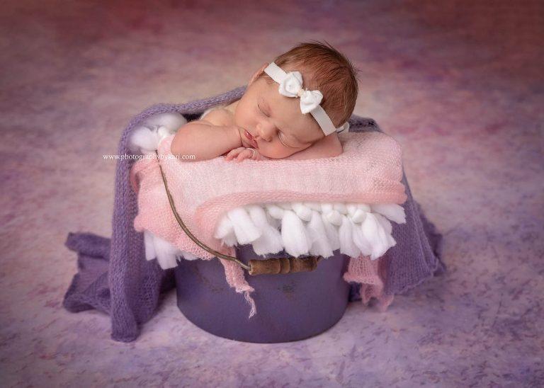 Grand Meadow Newborn girl portrait in bucket
